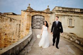 bride and groom walking down ramp of fort cristobal