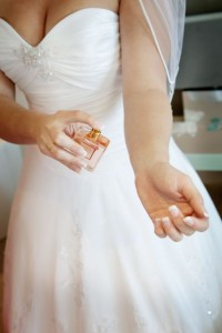 bride getting ready with perfume
