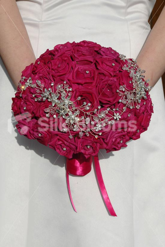 red roses and crystal brooch
