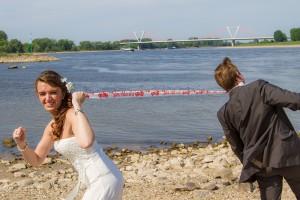 bride pulling groom