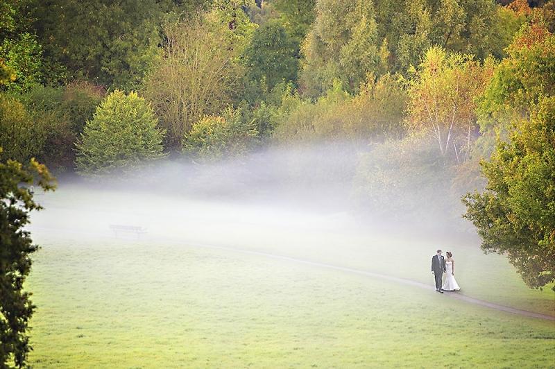 couple walking through mist