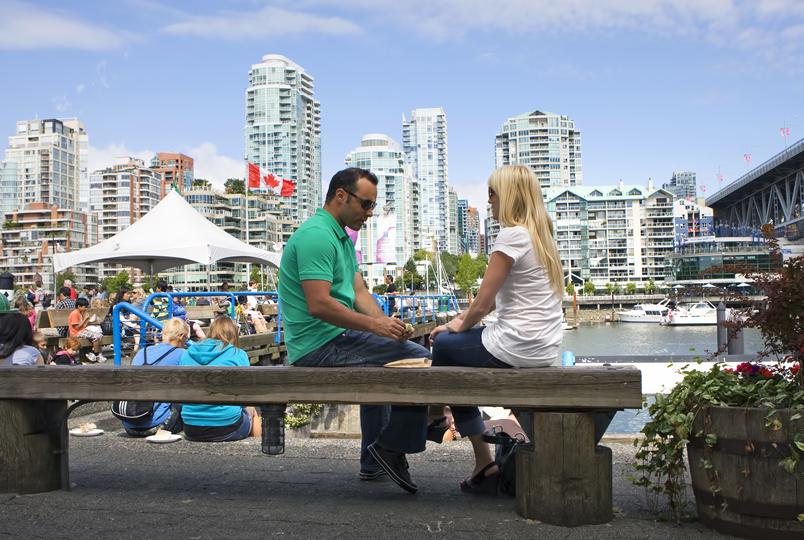 Couple enjoying at Granville Market. Photo Courtesy: Tourism Vancouver