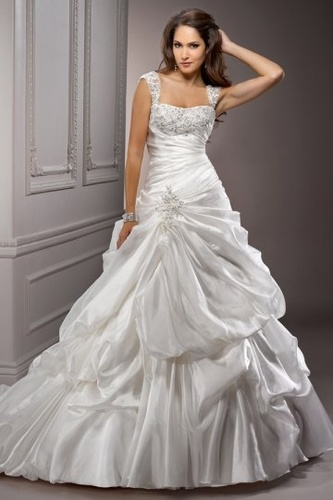 bridal gown by Heavens Above bridal boutique