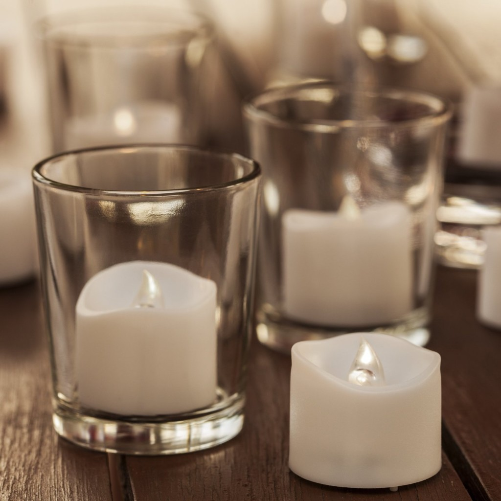 battery-operated candles in clear glasses