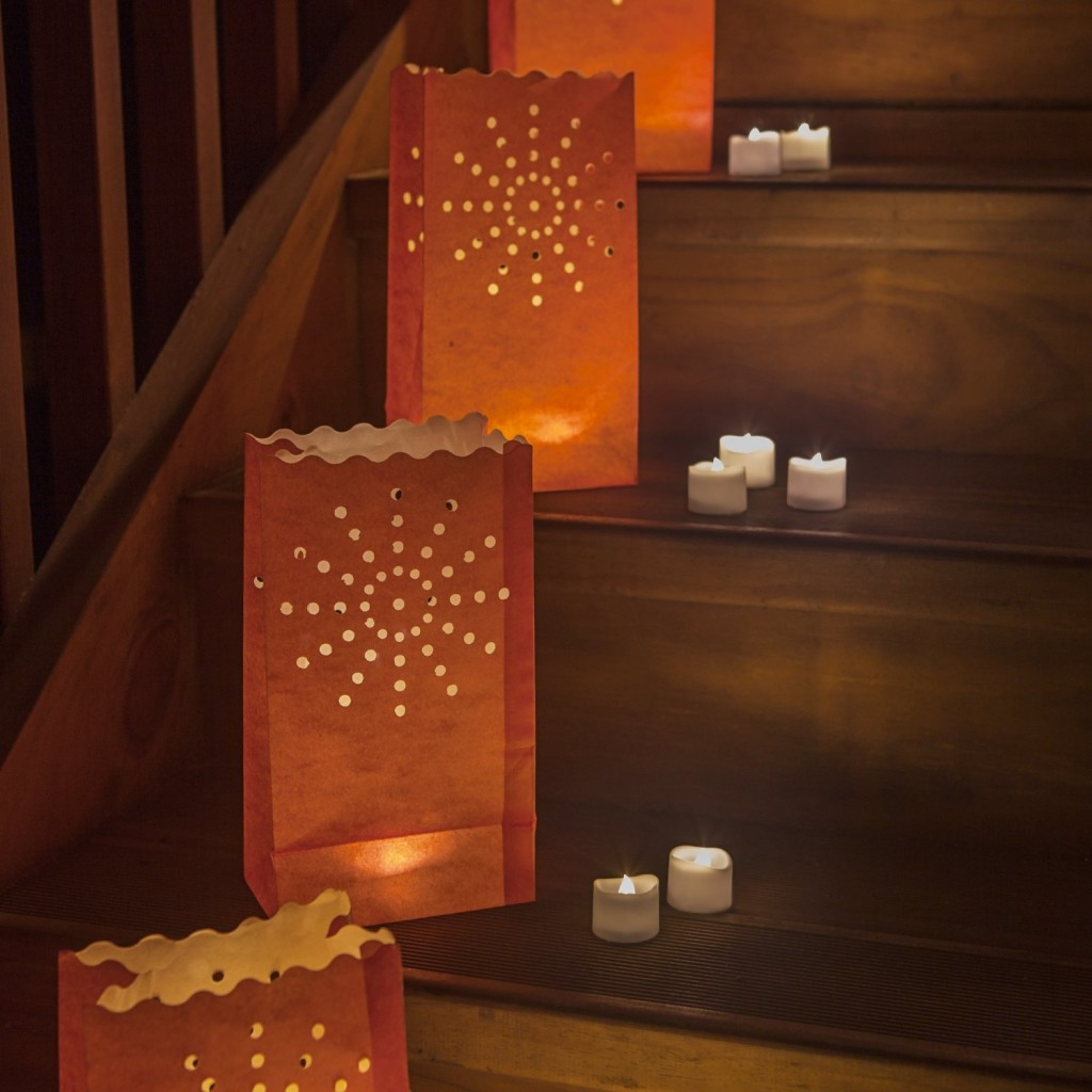 battery-operated candles in paper bags