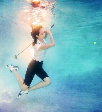 underwater bride playing golf