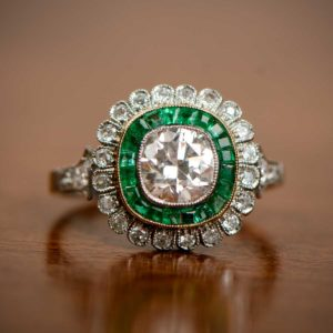 Emerald and Floral Halo Engagement Ring